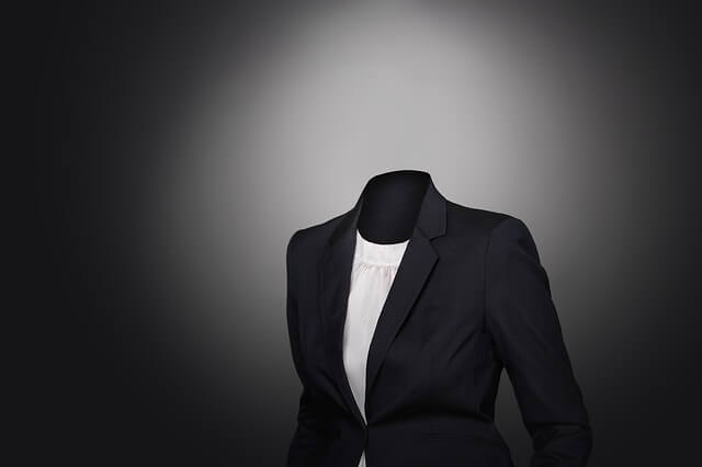 person staying anonymous without face in black business suite